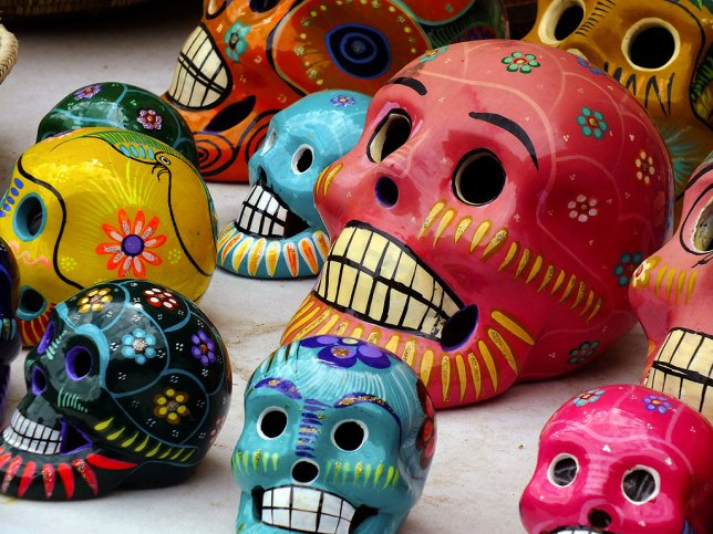 Traditional New Mexican painted skull art sits on display in a shop in Santa Fe's historic Plaza.