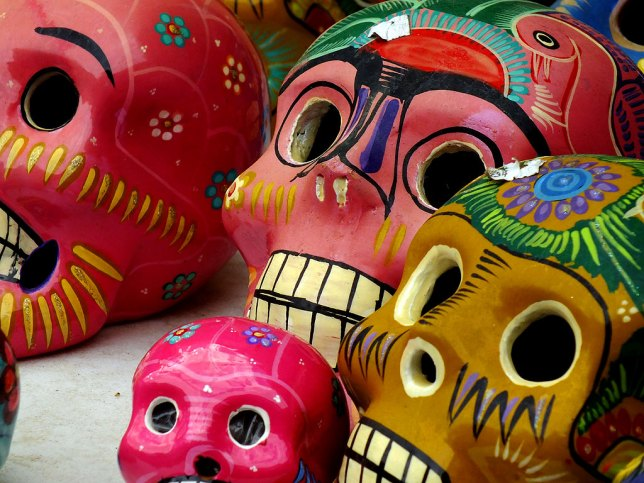 Traditional skull art sits on a table at a shop on The Plaza.