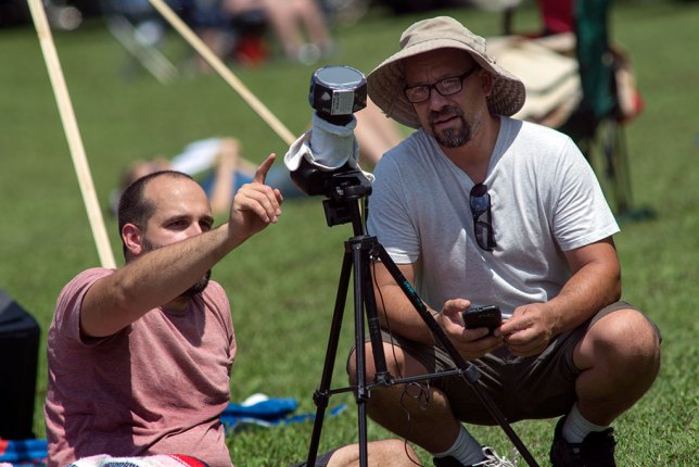 Eclipse viewers compare observations as the totality approaches.