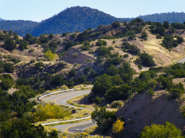 The winding, narrow New Mexico highway 503 curves past hills and through valleys on its way to Taos.