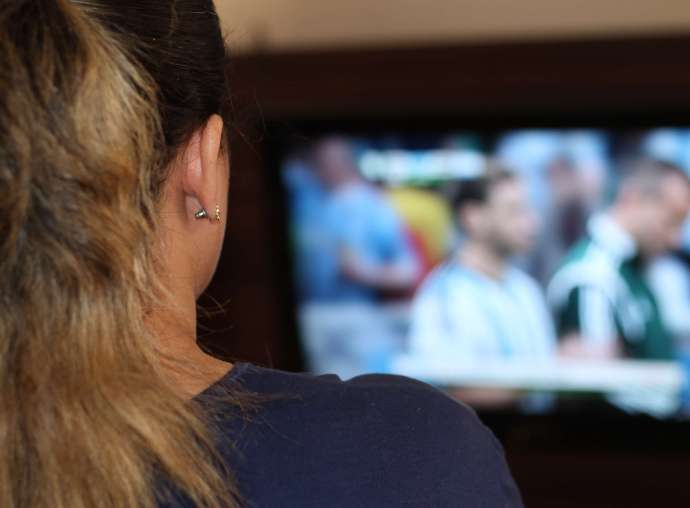 A woman watching television