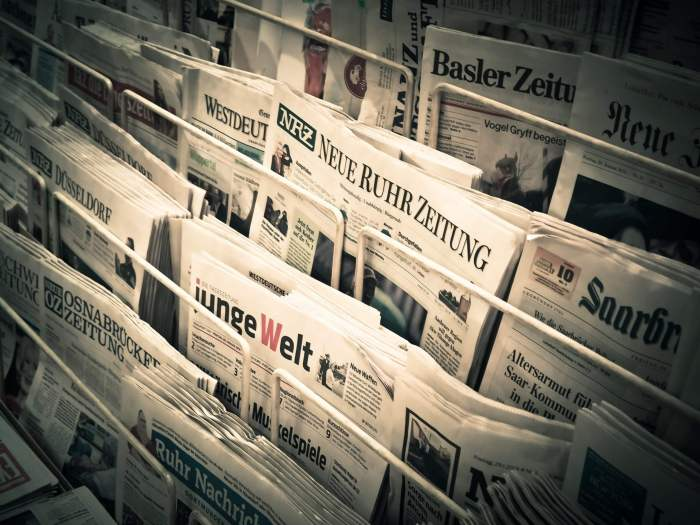an image of newspapers in a shop