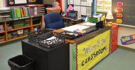 Teacher's desk in classroom.