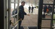 Man holding door open.