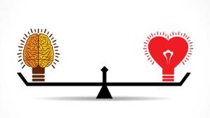 Brain and heart on balance scale.