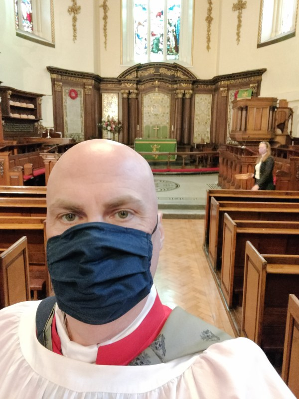 Selfie of me wearing my choir robes and face mask in St Ann's Church last Sunday