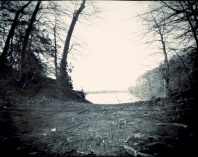 A path leads down through the trees to the reservoir. Shoe box pinhole camera, paper exposed 2 minutes, 30 seconds.