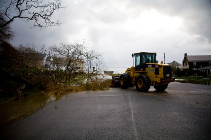 The bulldozers and heavy machinery get started clearing debris from the storm.