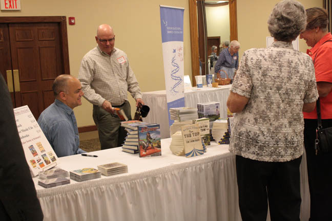 [Mike Perry, left, signed a book for me. Photo by Liz Adamshick, Hospice of Central Ohio.]