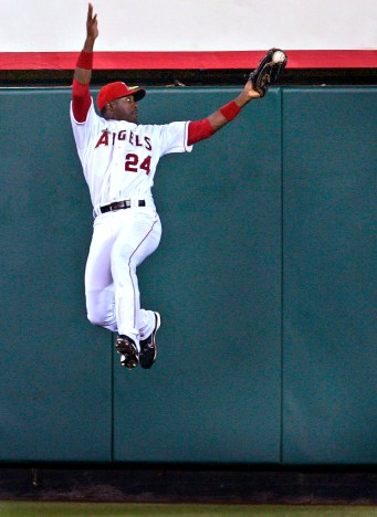 Angel centerfielder Gary Matthews Jr. leaps high up the wall to catch a shot hit by Texas Ranger Mark Teixeira to end the first inning at Angels Stadium in Anaheim Monday April 02, 2007. There was runner on third base.