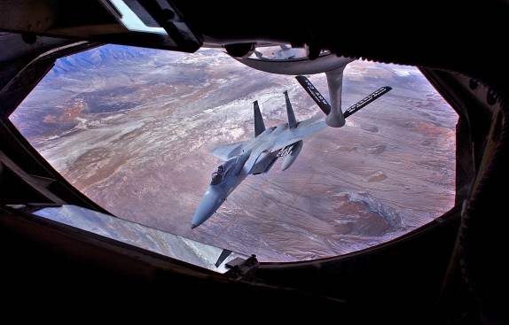 Looking through the window at the refueling pad of a KC-135 Stratotanker, an F-15 fighter jet peels off after fueling near the skies over Salt Lake City, Monday afternoon over Utah.