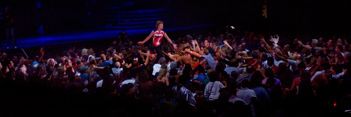 Mick Jagger slaps hands with fans as he makes his way up a runway during Rolling Stones concert, Thursday night at the Staples center in Los Angeles.
