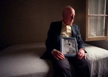 Holding a photo of his son, 82-year-old Julius Szabo, has a moment to himself in his bedroom at his home in Los Angeles. The Holocaust refugee who for years was just a grandfatherly benefactor in Mario Aguilar's life, actually was Mario's real father. Mario Aguilar was one the peolple killed in an Aspen, Colorado plane crash.