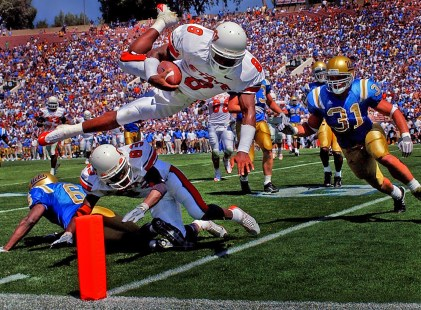 UCLA linebacker Benjamin Lorier (#31), right, can only waych as Oklahoma State quarterback Donovan Woods sails over the goaline for a touchdown during second quarter action at the Rose Bowl, Saturday in Pasadena.