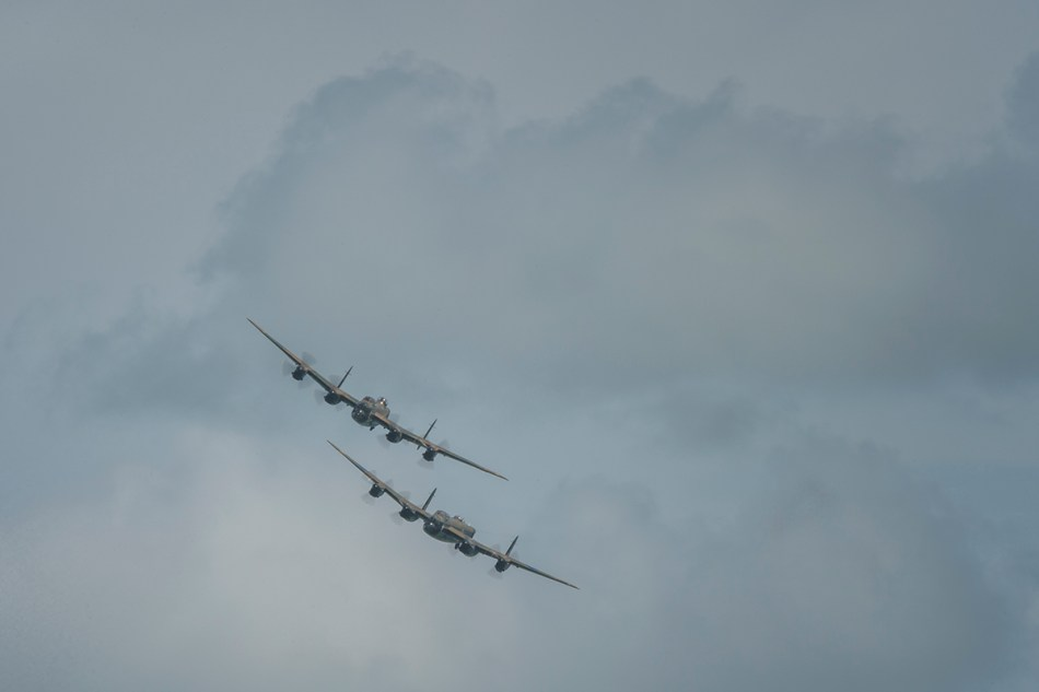 color images of two Avro lancastejs flying over the English Channel
