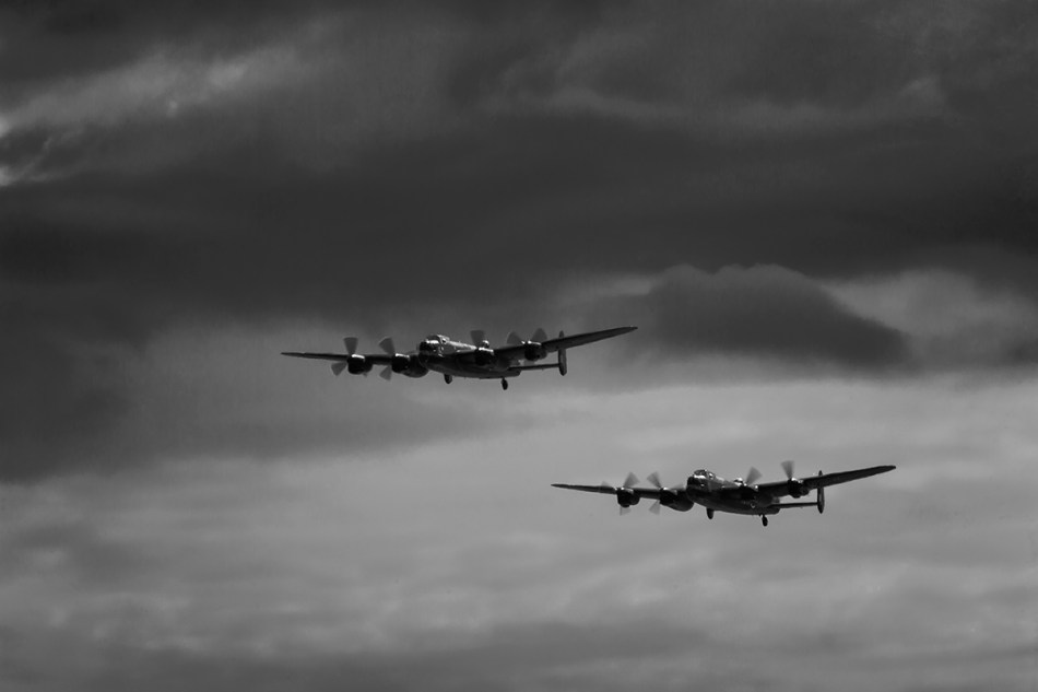 black and white image of two Avro lancastejs flying in formation