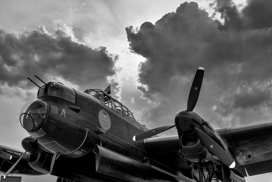 Black and white photograph of static Avro Lancaster Mk. X with stormy sky
