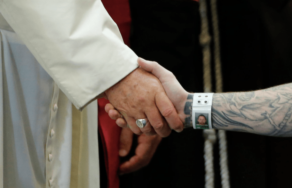 Pope Francis embraced and clasped hands with prison inmates in Philadelphia on Sunday, the last day of his United States visit. Credit Jonathan Ernst/Reuters