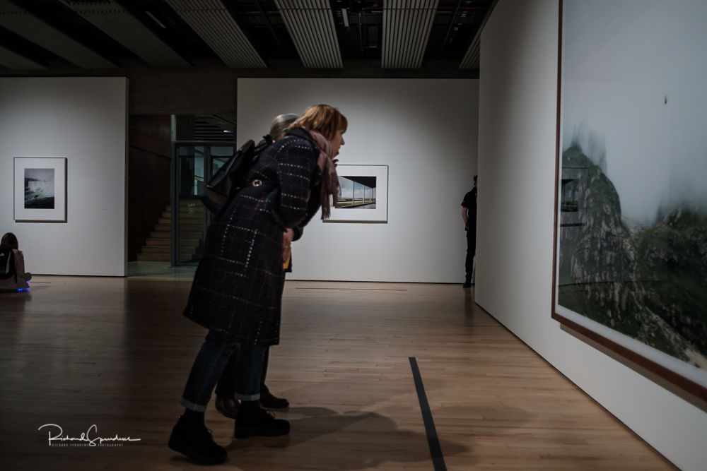 image taken in the hayward gallery focusing on the visitors viewing the Gursky images