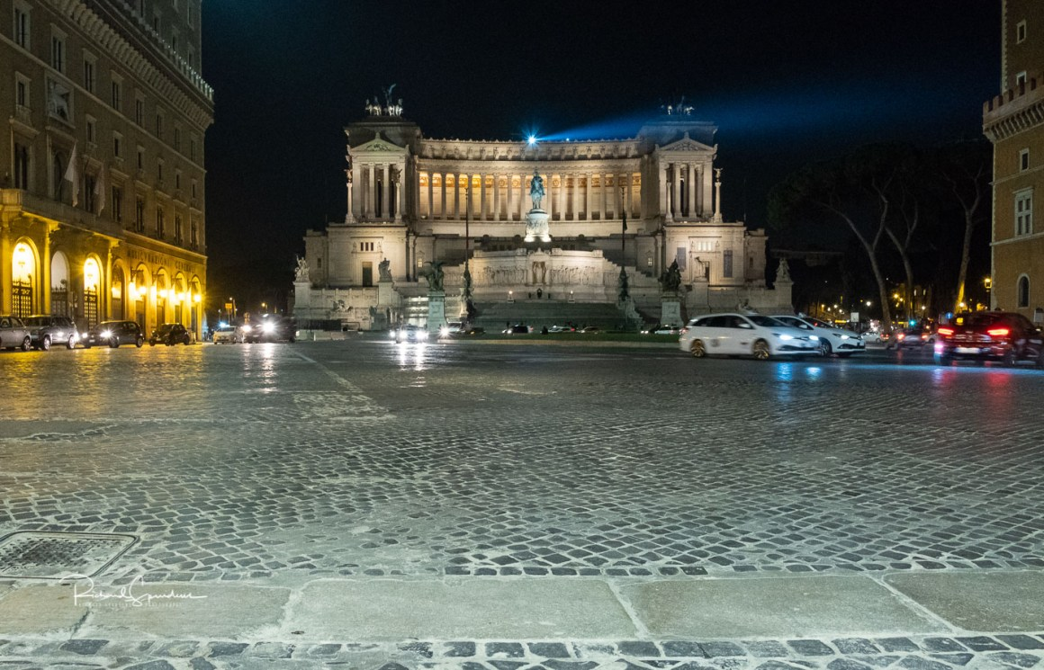 the piazza venezia roundabout almost free from cars give you a chance to see the impressive monumento nazionale building