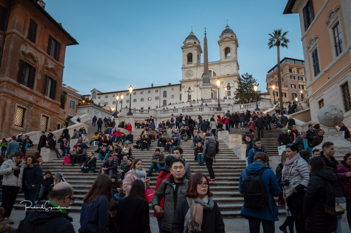 image from the spanish steps with the crowds of tourists covering the majority of the steps (photographing rome at night)