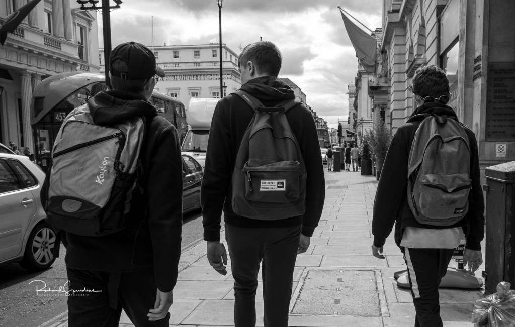 a b/w images of three young lads all with different back packs - shot to feature the back packs. london views with my fuji xt-2
