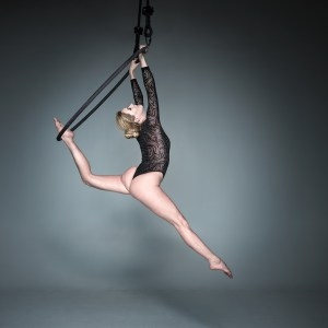 Aerial Arts photographer - Aerial hoop photographer - Aerial Arts photography - Aerial hoop photography - colour image of aerialist fanny m holding a dynamic pose in mid air using an aerial hoop