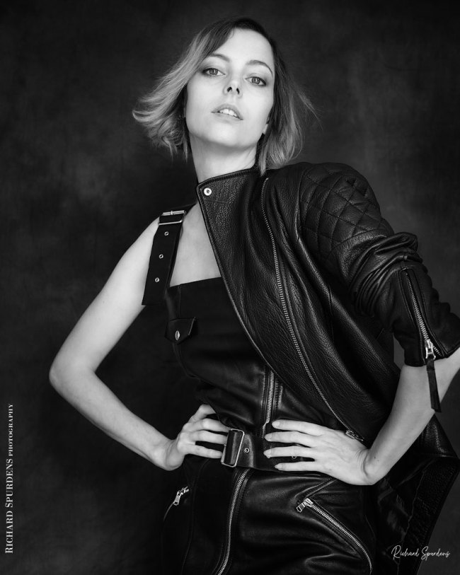 Fashion Photography - Fashion Photographer - monochrome image of model wearing a black leather skirt with attitude