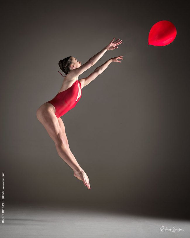 Dance Photographer - Dance photography - dancer leaping up trying to catch a red balloon as it floats away