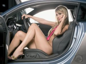 Hot Girl in High-Heels behind the wheel