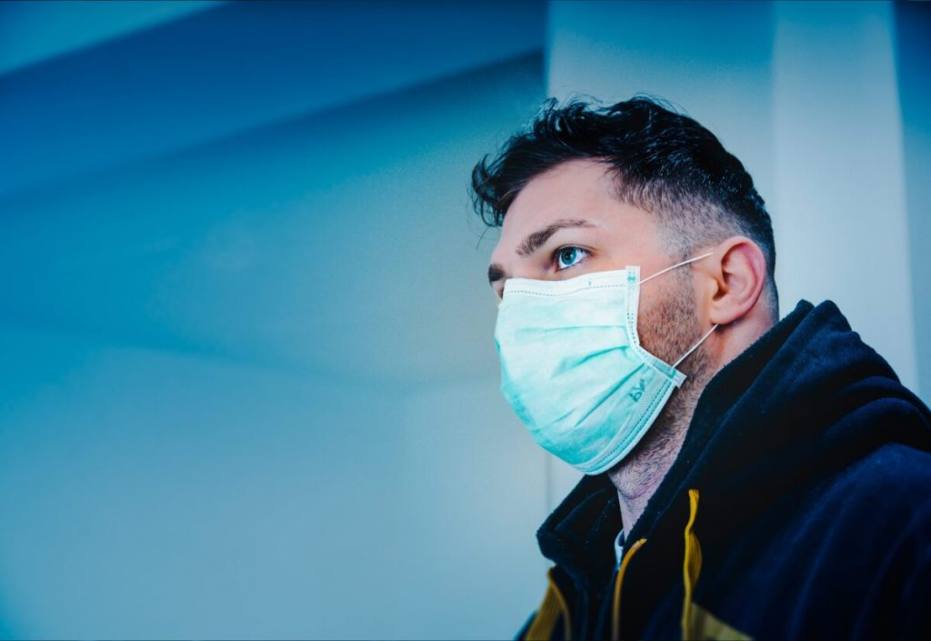 man-in-black-and-yellow-jacket-with-face-mask-3991782