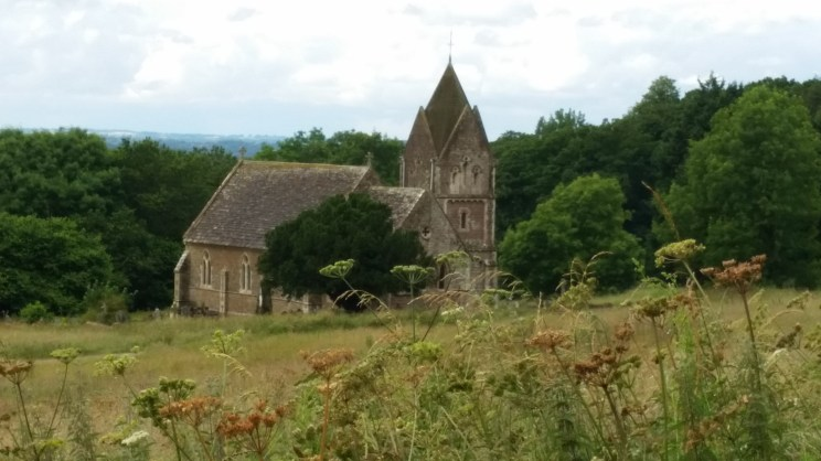 Quintissential church in middle of field English countryside x