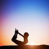 woman-bow-yoga-pose-meditating-sunset-zen-meditation-peace-51778609
