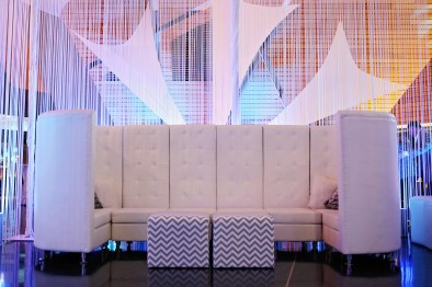 couch with draping and decor behind