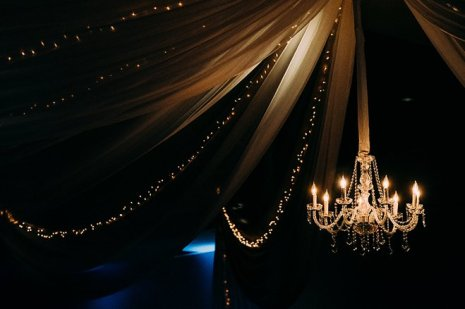 chandelier with drapery for wedding reception