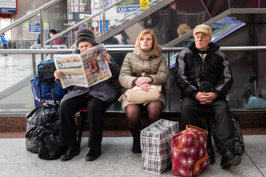 passengers waiting in a train station