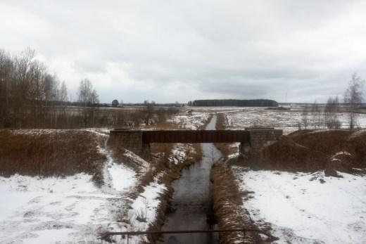 Belarus coutnryside landscape, a river and a small bridge.