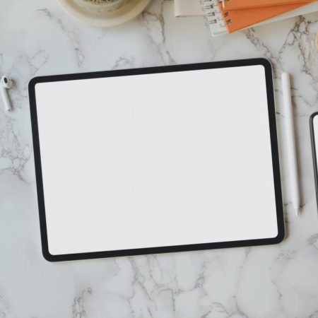 flat lay of black frame tablet
