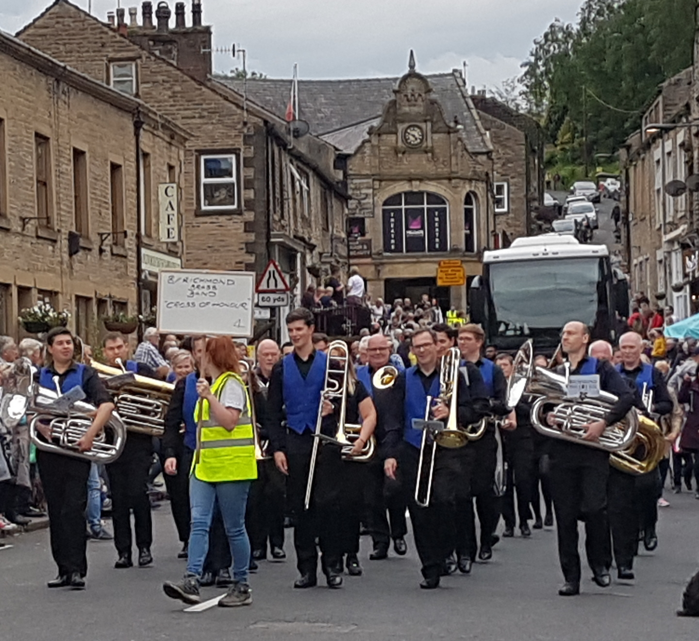 Richmond Brass Band marching through Delph