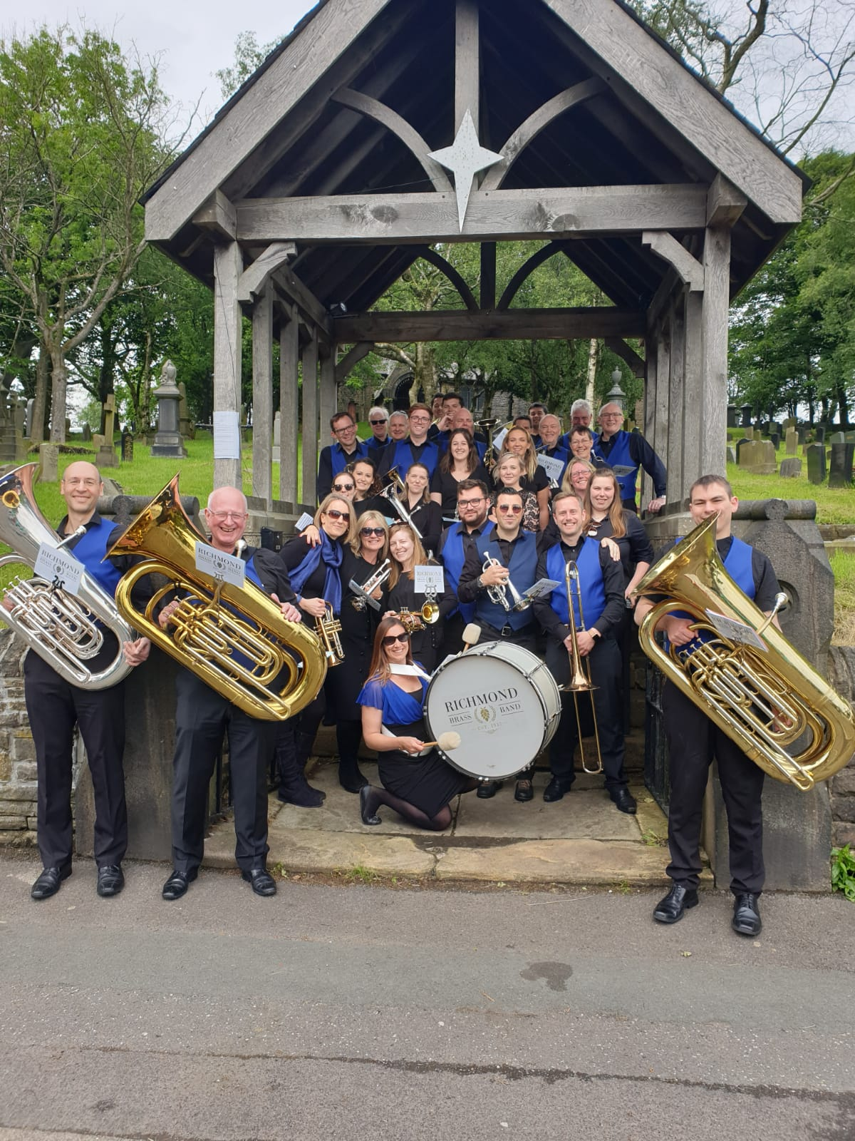 Richmond Brass Band under an arch in Denshaw