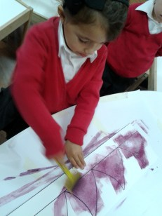 girl painting prickles