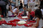 kids placing carnations