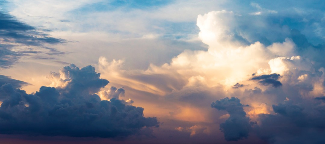 Clouds with sun breaking through. Discover a new world within you through analysis of your dreams at Richmond Psychotherapy with psychotherapist and counsellor Stuart Lee.