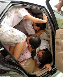 squeezing into a car