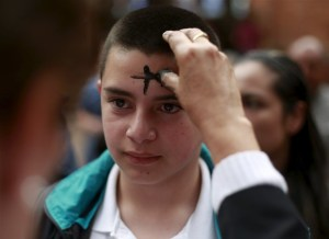 boy receiving ashes on forehead for ash wednesday