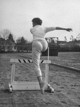 sheree north leaping over a hurdle