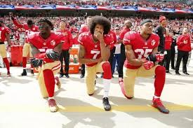 colin kaepernick taking a knee in protest before an nfl game