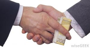 a handshake that includes a bribe