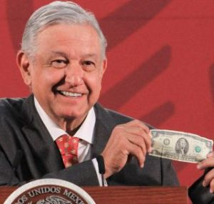 lopez obrador showing one of his good luck charms--a $2 bill--vocabulario en ingles