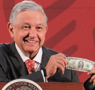 lopez-obrador-showing-one-of-his-good-luck-charms--a $2 bill--vocabulario en ingles